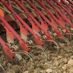 Seed drills with sweeps are more suitable for stonier soils